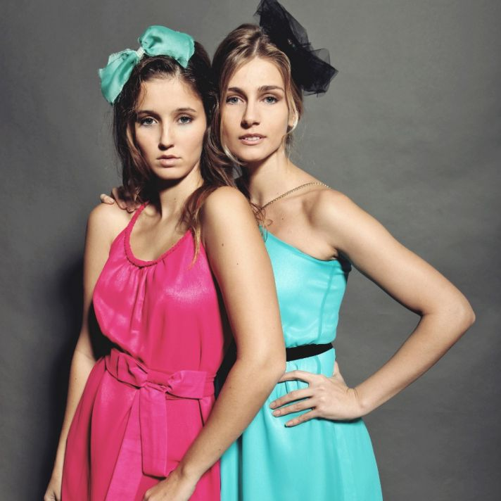 Bright fuchsia and aqua scoop neck bridesmaids' dresses with black sash