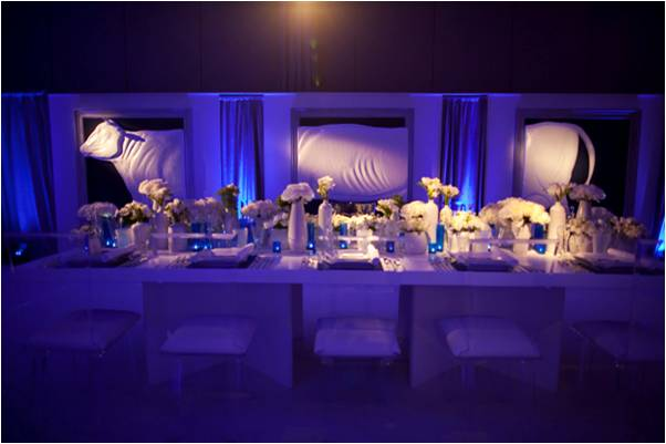 Credit Melissa Jill modern wedding reception decor with allwhite flowers
