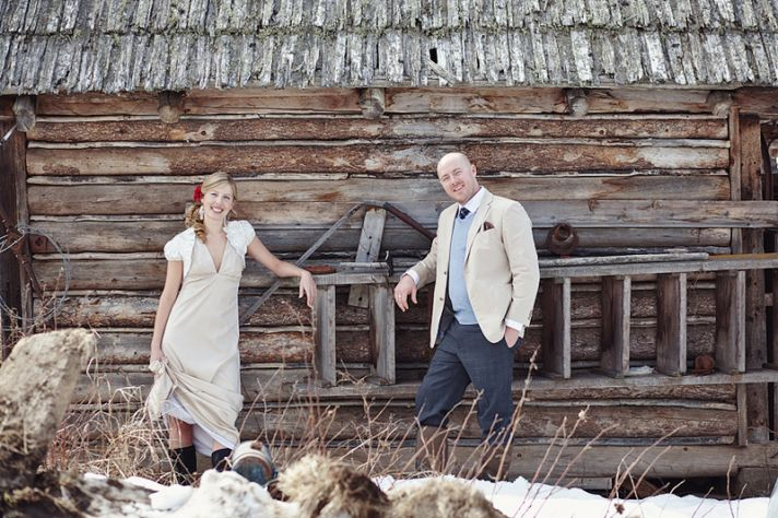 Rustic meets vintage wedding style- bride and groom pose outside