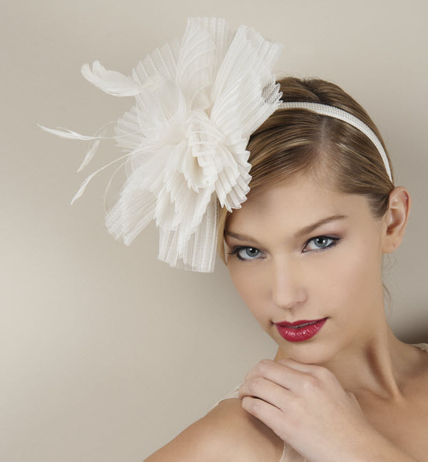 Coutureinspired bridal headband with oversized ivory flower