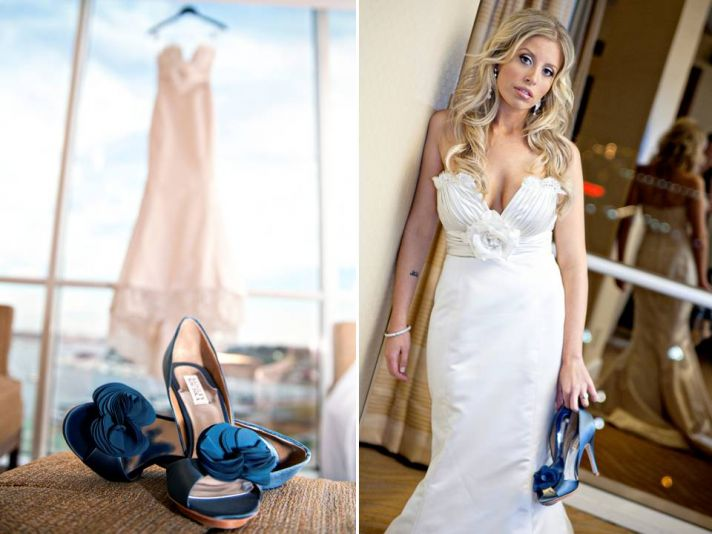 Ivory lace wedding dress hangs in window of wedding venue, bride holds blue peep-toe wedding heels