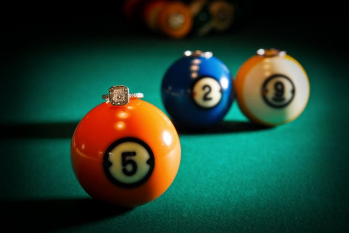 Hip, retro engagement session in Chicago at old pool hall; cushion cut diamond engagement ring shot