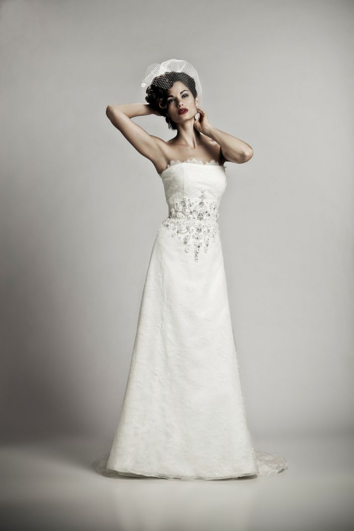 Classic white modified a-line strapless bridal gown with beading embellishment
