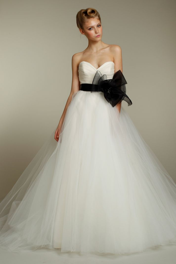 One-shoulder ivory silk taffeta wedding dress with romantic ruffle embellishments