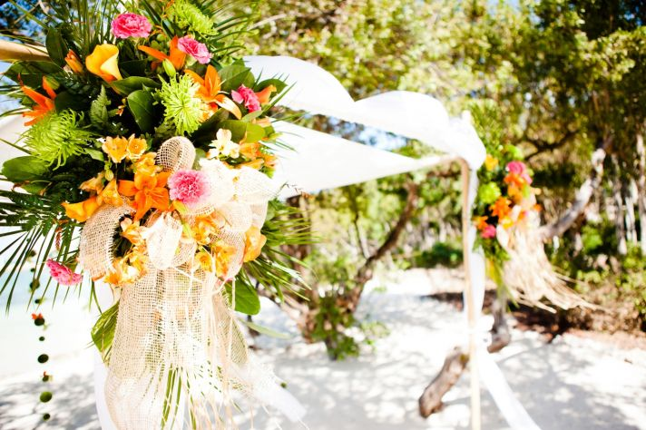 Tropical wedding reception decor with a beach theme and unique table centerpieces