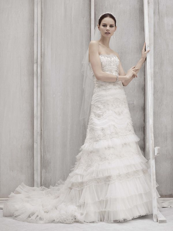 Ivory strapless lace wedding dress by Oleg Cassini