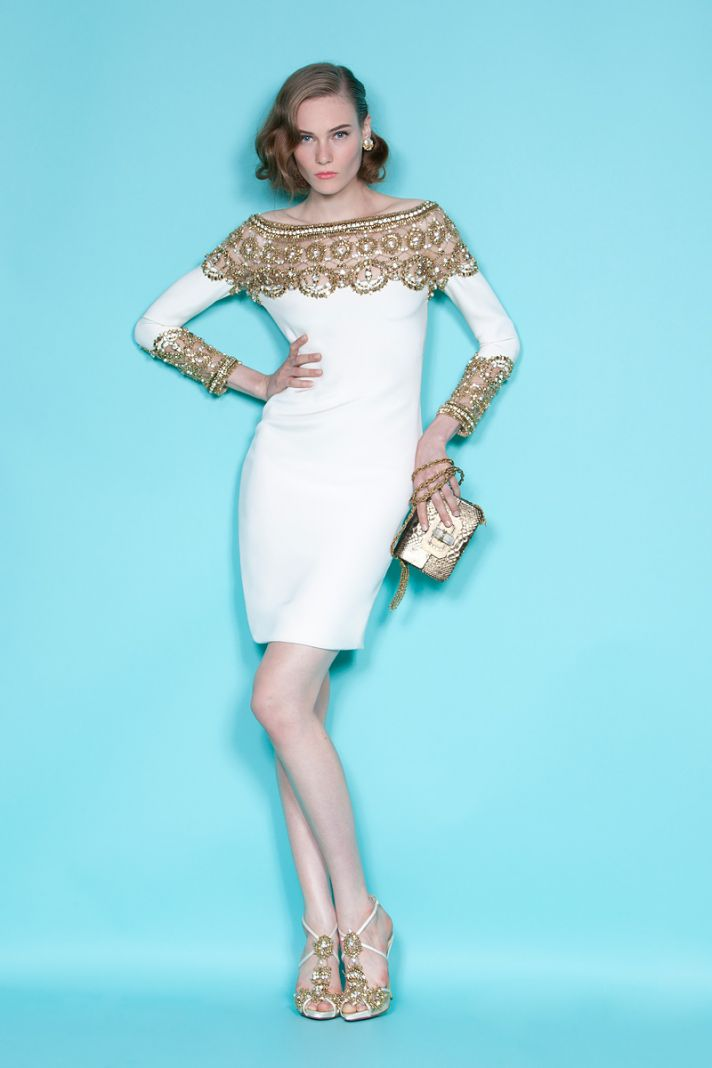White sleeved wedding reception dress with gold neckline