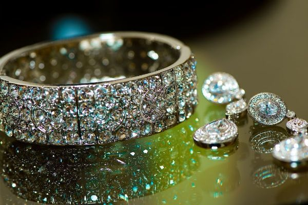 Dazzling bridal cuff bracelet and drop wedding earrings