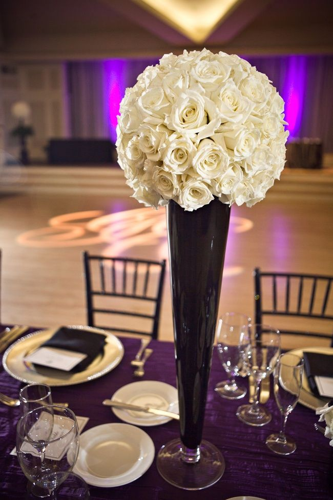 rose flower ball atop chic black vase for wedding reception centerpieces