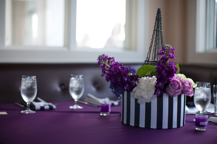 Purple and ivory Paris-themed wedding- elegant floral centerpieces