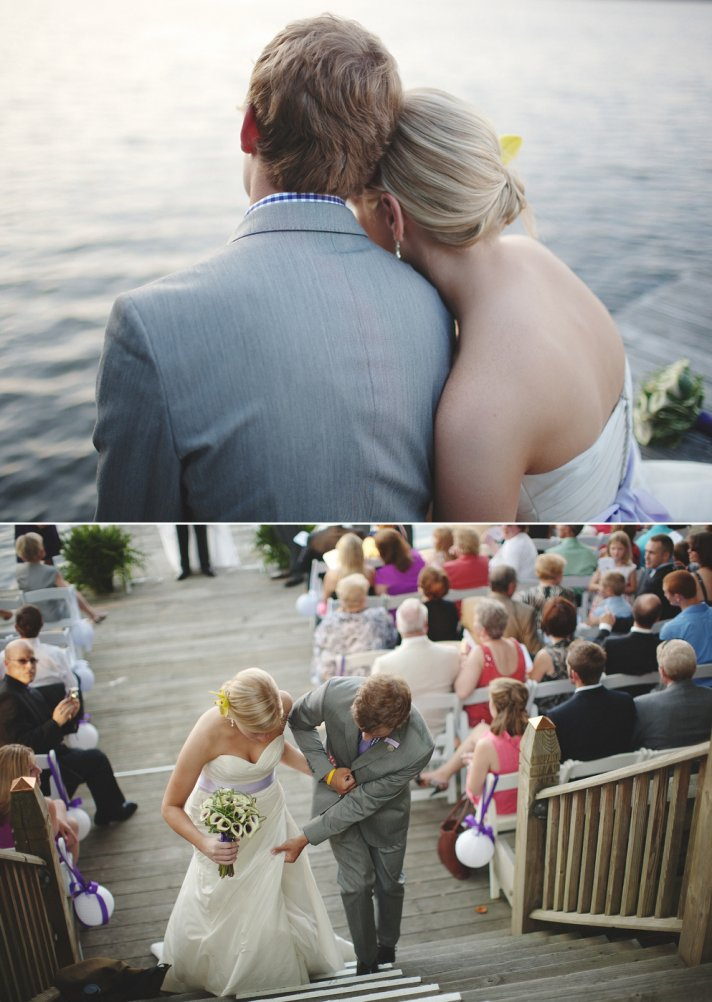Bride and groom pose on dock near outdoor wedding venue