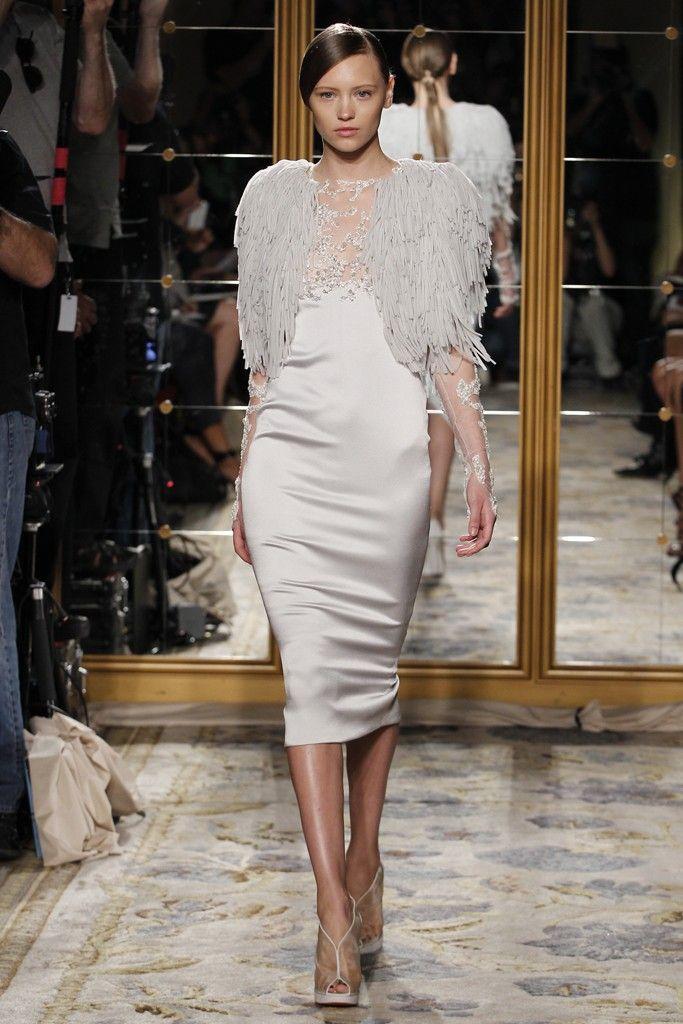 Sleek ivory wedding reception dress with dramatic fur bridal shrug