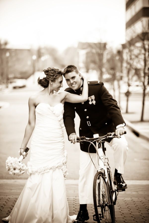 Romantic black and white wedding photo of Jewish bride with military groom