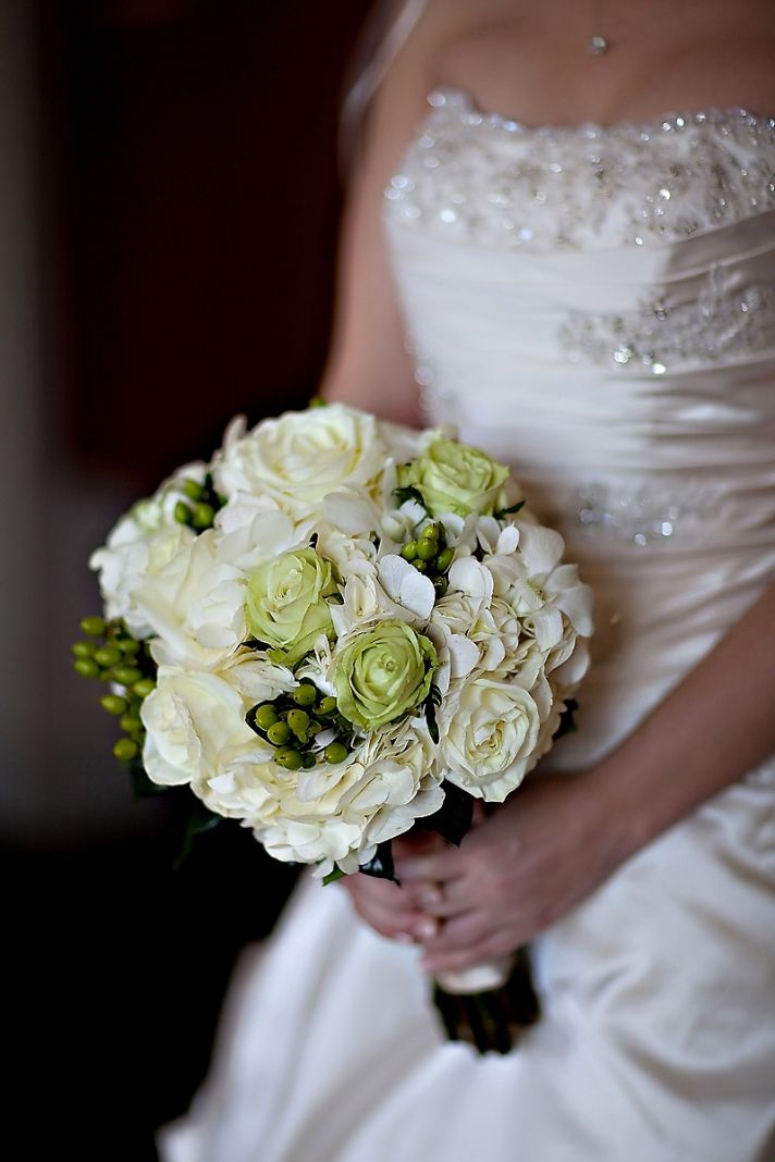 Ivory beaded wedding dress, ivory and green bridal bouquet