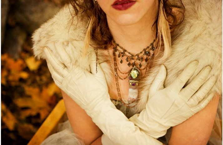 dark romance bride wears red lips fur bridal bolero
