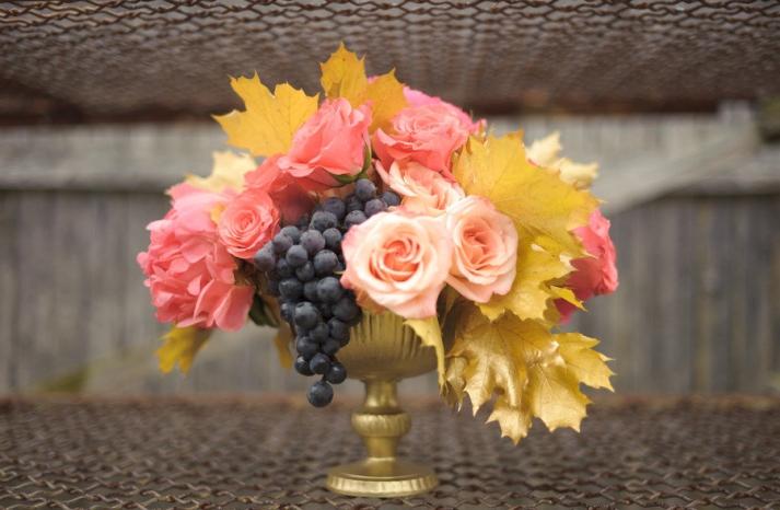 winery wedding bright reception centerpiece gold vase