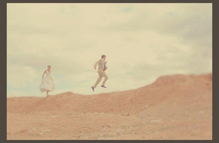desert wedding offbeat wedding style casual bride groom run through desert