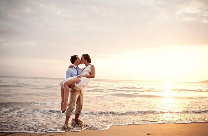 destination wedding on beach bride groom kiss