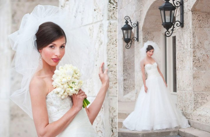 bride wears white a line wedding dress pouf bridal veil