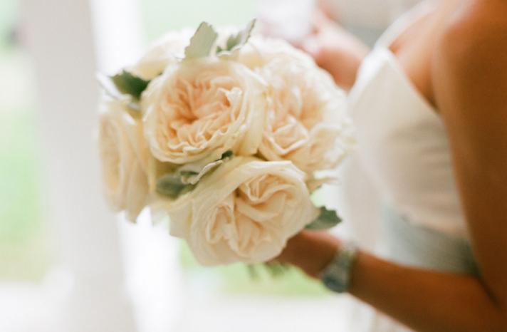 elegant real wedding outdoor reception under tent ivory bridesmaid bouquet