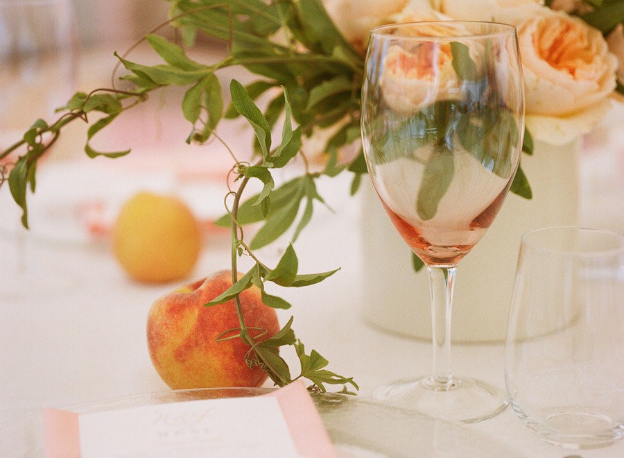 elegant real wedding outdoor reception under tent peaches used for