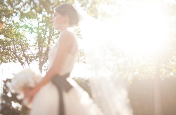 bride wears white vera wang ballgown black sash