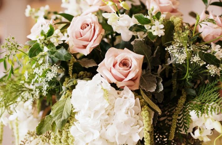 elegant spring wedding centerpiece roses hydrangea
