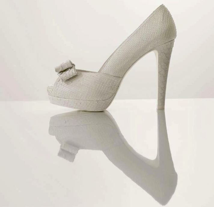 splurge worthy wedding heels white platform bridal pumps with bow detail