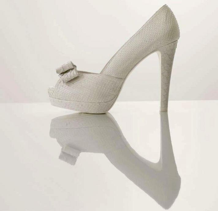 splurge worthy wedding heels white platform bridal pumps with bow detail