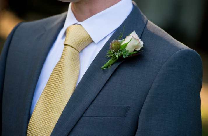 classic grooms attire grey suit rose boutonniere