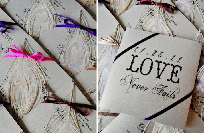 feather adorned wedding reception escort cards