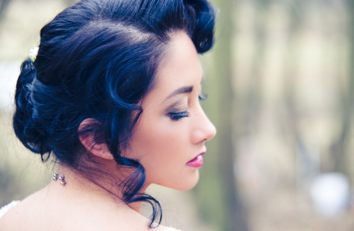vintage bride with dark hair parted bridal updo