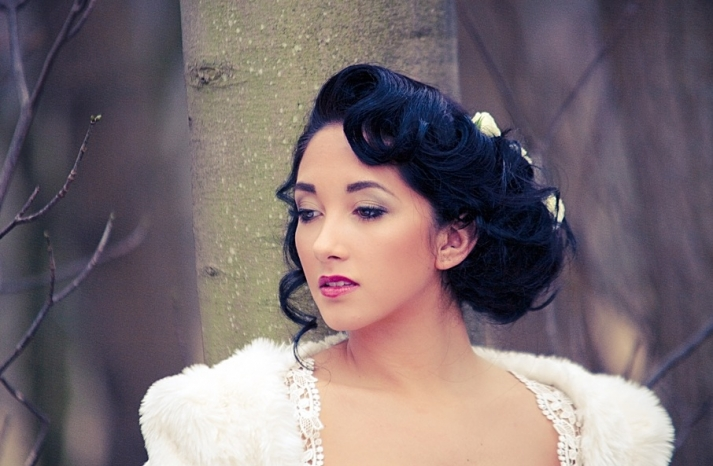 retro waves wedding updo with flower accents 1