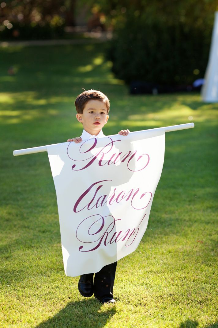 elegant California wedding with bold florals personalized details funny wedding sign