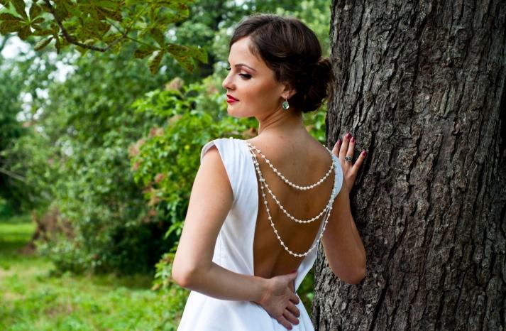 open back wedding dress strands of pearls