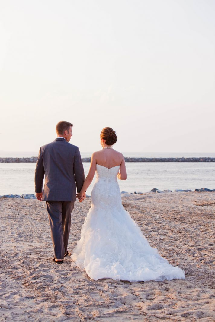 Bride and Groom walk hand in hand after saying I Do