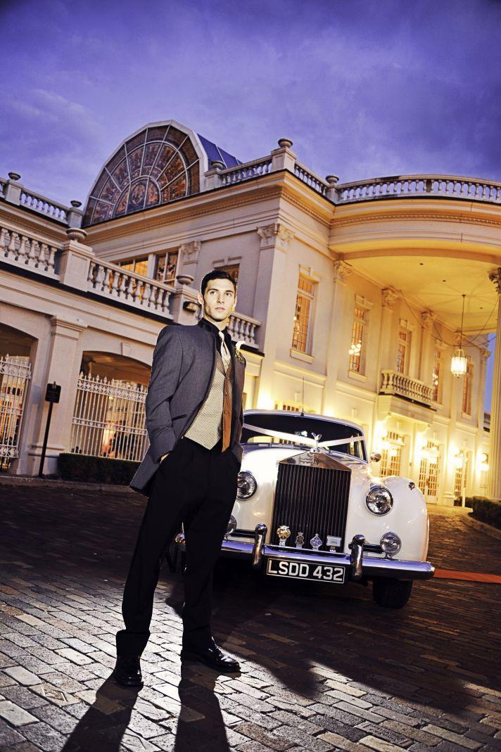 Opulent Wedding Venue Vintage Groom Poses with Rolls Royce