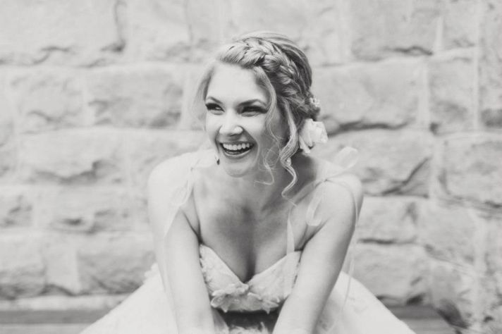 romantic braided wedding hairstyle with curly tendrils