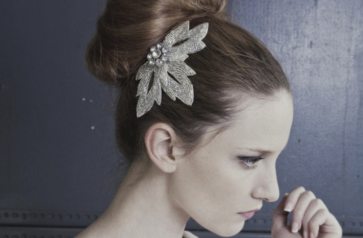 High bun wedding hairstyle with beaded vintage clip