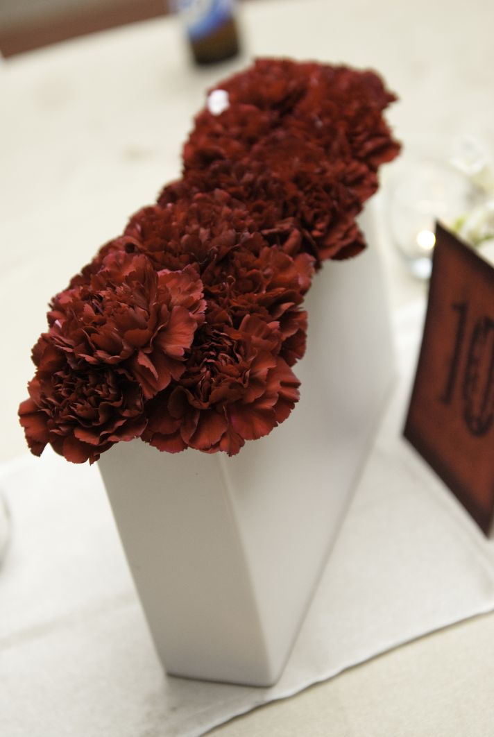 Modern budget friendly wedding centerpiece with red carnations