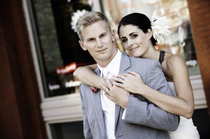 Beautiful bride poses with groom Milwaukee wedding