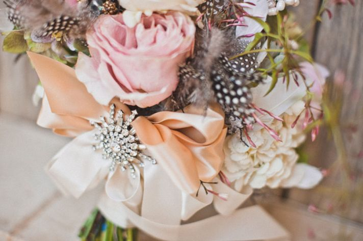 Romantic rose bridal bouquet with feathers
