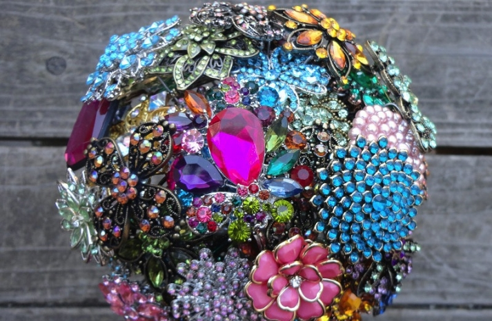 Colorful wedding bouquet of vintage brooches