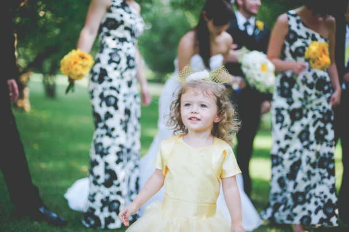 Yellow white black wedding with cute flower girl and stunning centerpieces