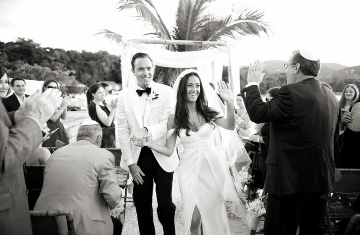 Groom wears ivory tux jacket black bow tie