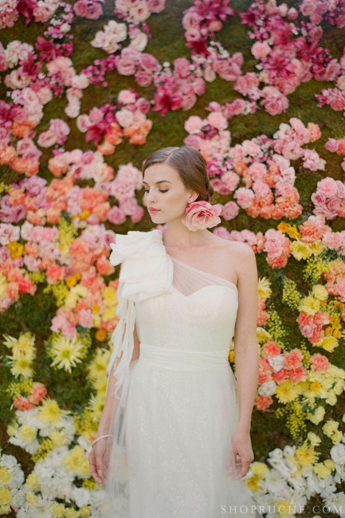 Enchanted wedding backdrop of yellow orange pink blooms