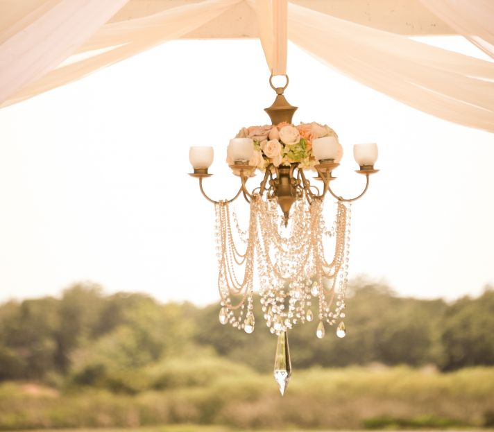 Crystal wedding chandelier with flowers and candles
