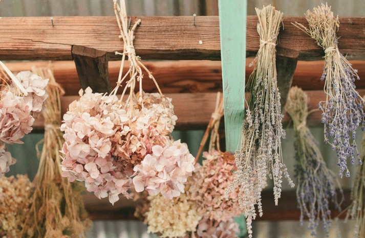 Dried hydrangeas decorate rustic wedding venue