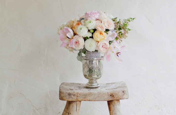 Pastel spring wedding centerpiece with ranunculus