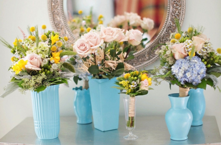 spring wedding flowers in aqua vases